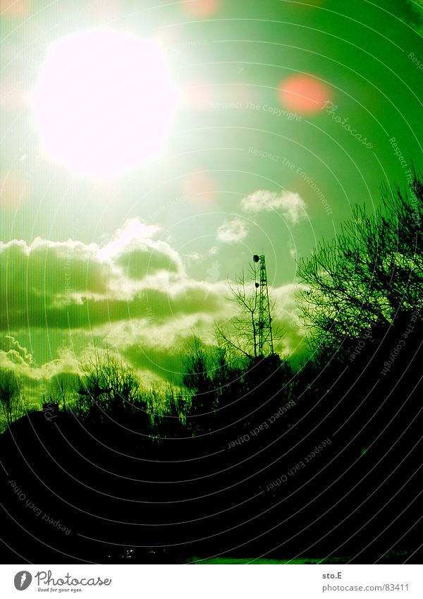 Green Sun Bright Flashy Broadcasting tower Lens flare Monochrome Shaft of light Illuminating Clouds in the sky Luminosity Green undertone