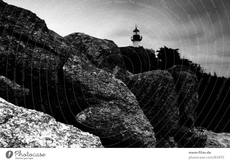 lighthouse Rocky coastline Lighthouse Coast Brittany France Ocean Low tide Ledge Beach Black & white photo Island on the coast
