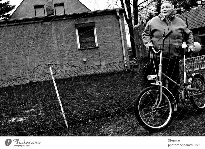 storm damage To talk Village road Chatty Folding bicycle Nostalgia for former East Germany Grandmother Farm Neighbor Fence Woman Senior citizen Wire netting