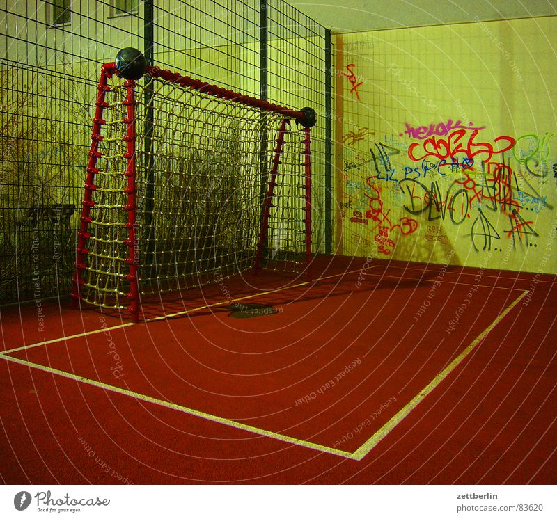 Playground {m} = playground Corner Tartan Vacuum Generation gap Soccer Goal Penalty area Wall (building) Night Playing Ball sports Soccer team Death Empty Red