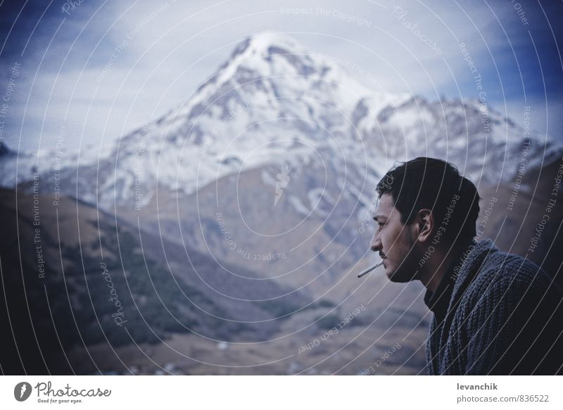 mountain Human being Young man Youth (Young adults) 1 Youth culture Sky Ice Frost Snow Smoking Blue Sadness Mountain Boy (child) Evening Portrait photograph