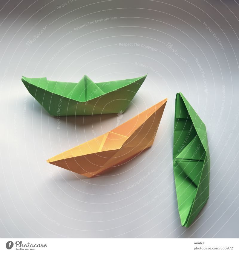 ship graveyard Work of art Collapsible boat Paper Paper boat Transport Means of transport Navigation Sharp-edged Simple Together Yellow Green Crisis Dangerous