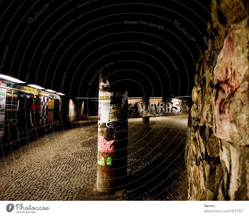 ghetto Placard Aachen Advertising column Wall (building) Neon light Dark Wall (barrier) Poster Night Wide angle Loneliness Tunnel Ghetto Town Harmful Tramp