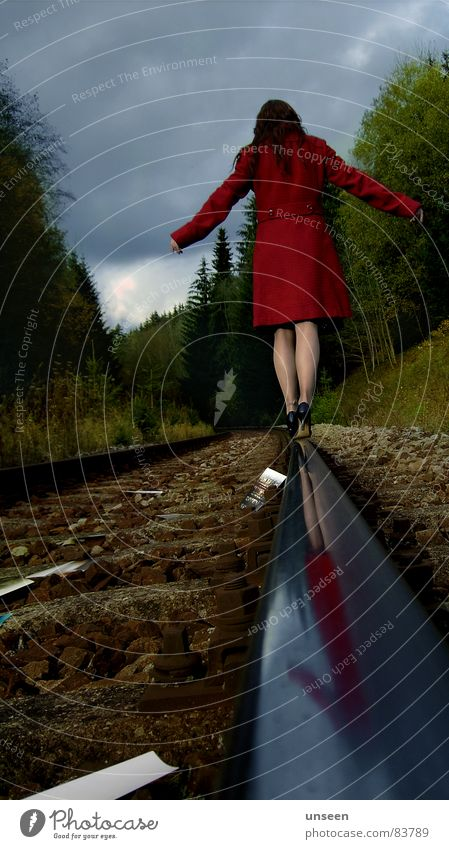 take care Feminine Woman Adults Legs 1 Human being Sky Autumn Forest Railroad tracks Coat Green Red Colour photo Exterior shot Copy Space top Day Reflection