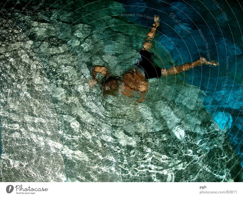 night swimming Dive Night Vacation & Travel Joy Sunbathing Swimming pool Romp Damp Lust Wet Sports Playing Summer water r blue Floodlight bubbles boy leg young