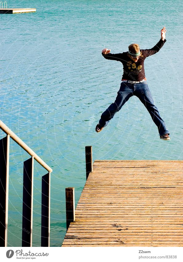 Human being Man Water Joy Yellow Jump Style Movement Wood Lake Warmth Legs Action Jeans Island Broken
