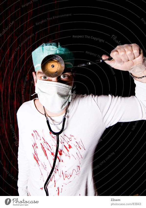 "doctor ""kuddl"" - crazy Saw Doctor Surgeon Surgery Hospital Operation Lamp Mask Forehead Crazy Go crazy Stand Portrait photograph man gloves look eyes sick Blood"