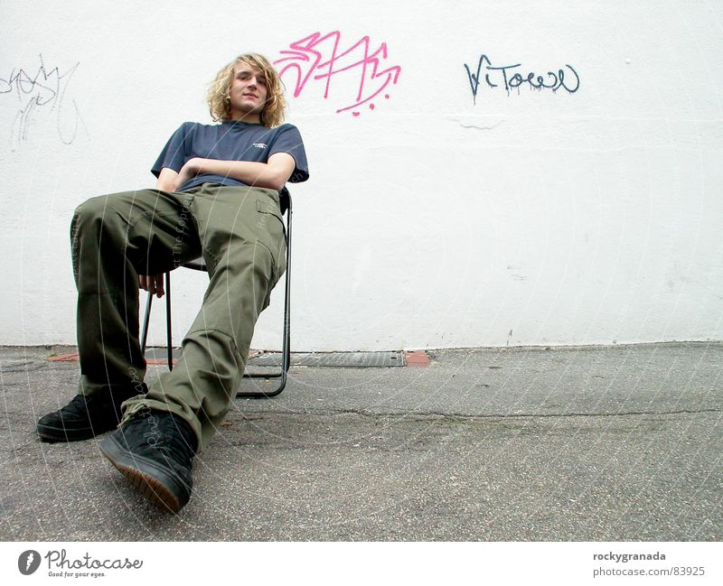 soon come Wall (building) Graffiti Wide angle Relaxation Youth (Young adults) Original Human being Man Townsfolk Chair Sit Wait easy Character townspeople