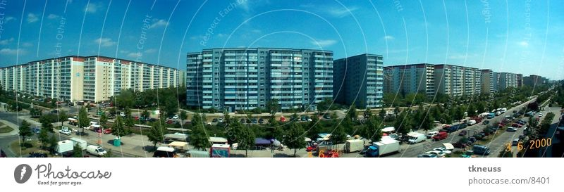 Berlin Architecture Road traffic Large Panorama (Format) Capital city Blue sky Prefab construction Housefront Residential area Tower block Overpopulated