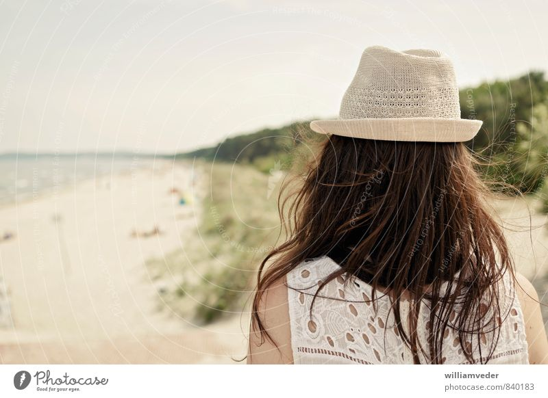 Girl from behind with hat in front of beach panorama Wellness Harmonious Well-being Swimming & Bathing Vacation & Travel Tourism Trip Freedom Summer