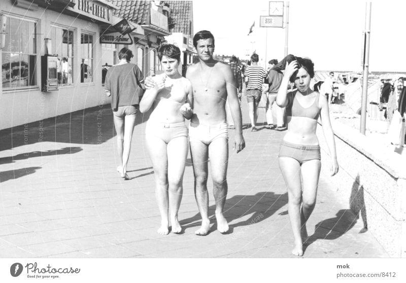 Woman Man Water Ocean Beach Vacation & Travel Group Ice Retro Black & white photo Bikini Boredom Sixties Clothing Sylt Swimming trunks