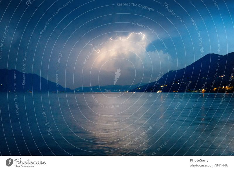 The moment. Sky Storm clouds Night sky Thunder and lightning Lightning Hill Lake Threat Dark Blue Black Lago Maggiore Colour photo Exterior shot