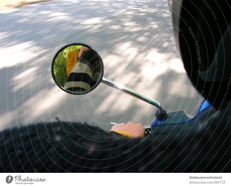 The beautiful moped ride Scooter Mirror Driving Speed Reflection Autumn very fast