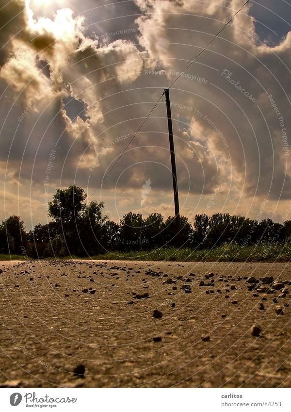as soon as I lie here taking pictures ... Electricity pylon Illusion Worm's-eye view Crystal ball Gap in the clouds Going Asphalt Tar Sunbeam Wonder
