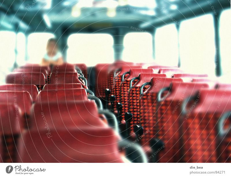 Human being Red Transport Firm Bus Seating Row of seats Shaft of light Free space Rear seat