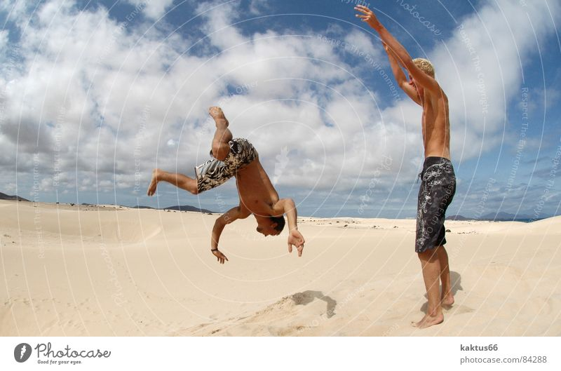 Sky Vacation & Travel Youth (Young adults) Sun Ocean Joy Beach Sports Flying Brown Sand Jump Air Earth Stand Happiness