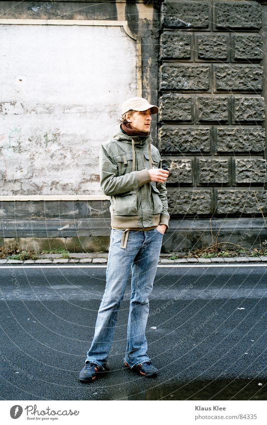 Man Hand Green Street Wall (building) Wall (barrier) Railroad Jeans Jacket Cap Bag Disc jockey Puddle Relief Rain gutter