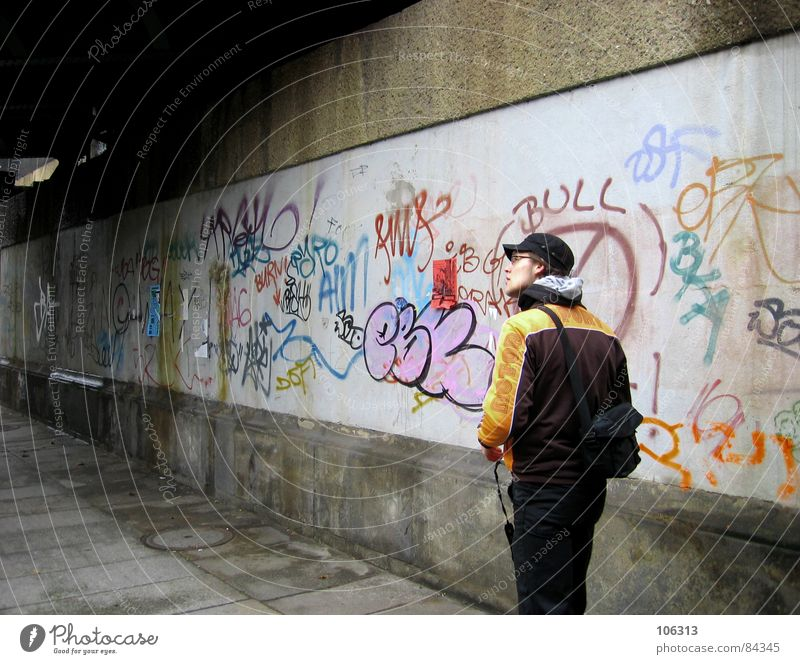Human being Man City Graffiti Wall (barrier) 18 - 30 years Dresden Sidewalk Cap Tunnel Guy Quarter Pedestrian In transit Fellow Street art