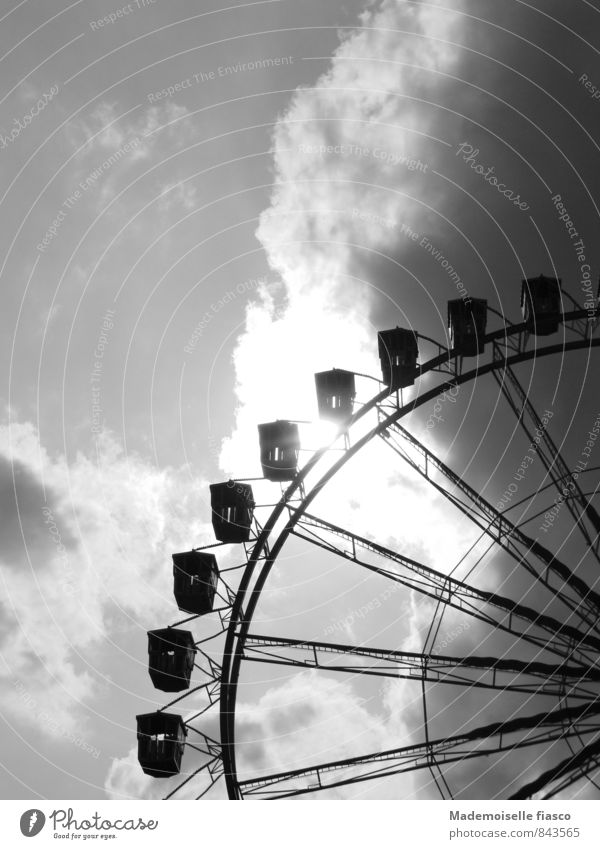 Ferris wheel against the light Leisure and hobbies Fairs & Carnivals Clouds Storm clouds Sunlight Summer Threat Dark Large Tall Above Gray Black White