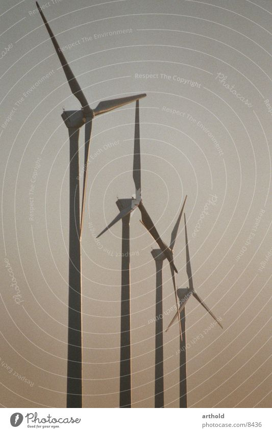 Wind power in the evening light Wind energy plant Industry windmills Energy industry renewable energy sources Renewable energy