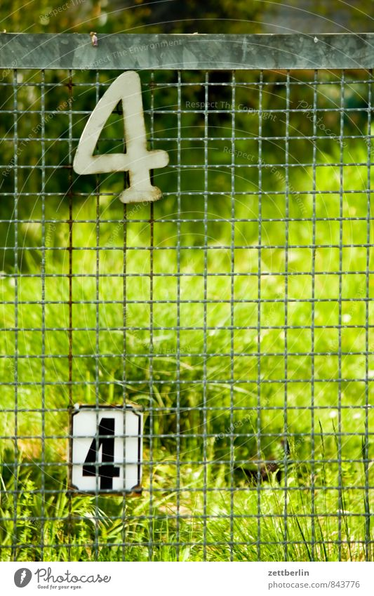 44 Berlin Garden Garden plot Garden allotments Town Suburb Digits and numbers House number Fence Wire netting fence Neighbor Border In pairs Grass Meadow Green
