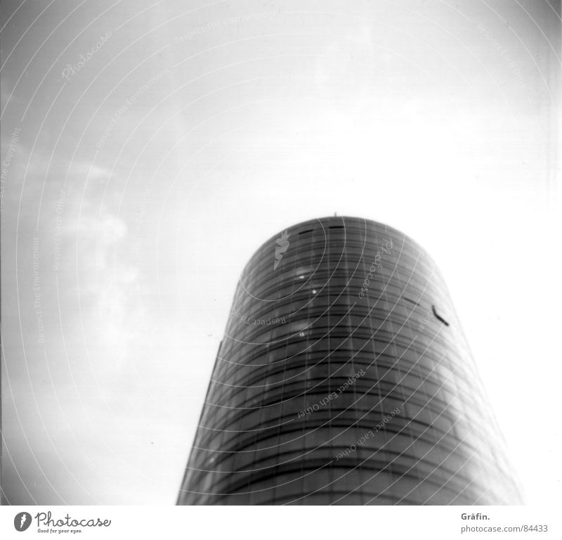 Glass tower Building Holga Black Round Window House (Residential Structure) Manmade structures Lomography Modern Tower Sky Black & white photo Construction site