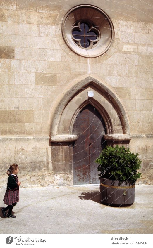childhood Child Retro Spain Europe Mediterranean Majorca Vacation & Travel Bushes Door Gate Exterior shot Toddler Portal Passage Herbaceous plants