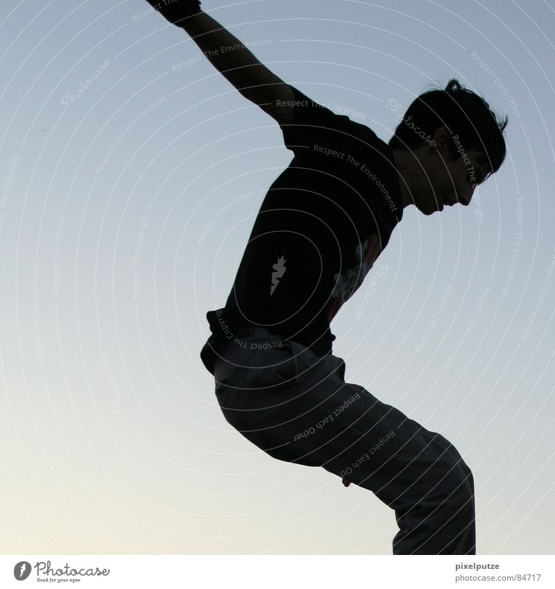 Human being Sky Man Youth (Young adults) Blue Black Freedom Movement Jump Air Places Action Posture To fall Beautiful weather Division