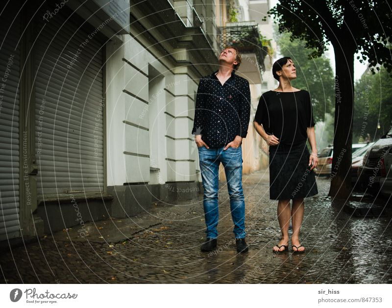 Human being Woman Man City House (Residential Structure) Dark Adults Street Love Berlin Couple Friendship Rain Authentic Stand Capital city