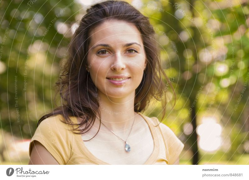 Portrait of a beautiful young woman at park Human being Woman Nature Youth (Young adults) Beautiful Green Summer Relaxation 18 - 30 years Yellow Face Adults Meadow Happy Park Lifestyle