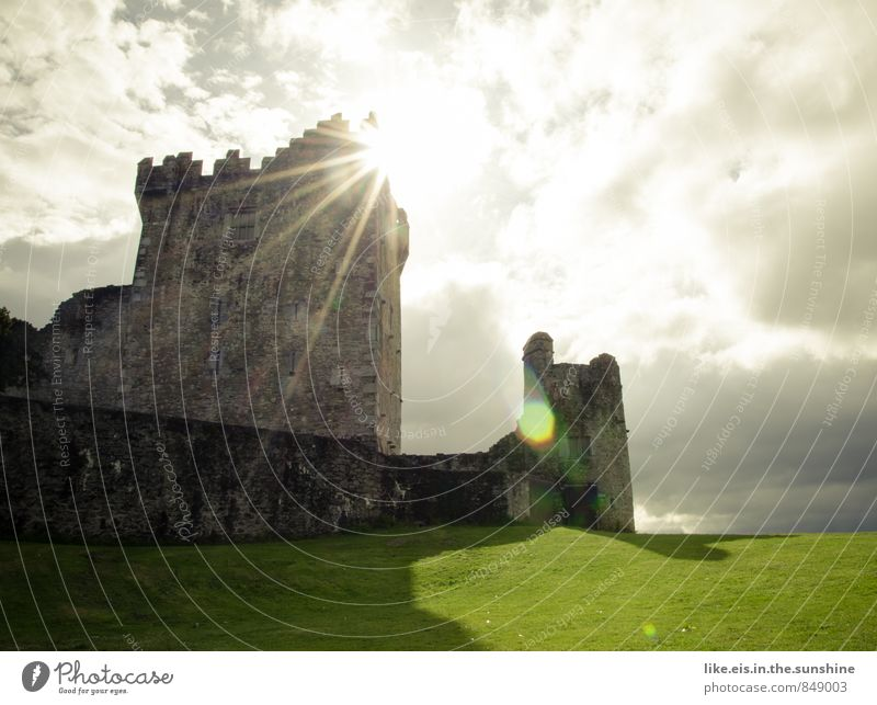 Nature Vacation & Travel Loneliness Clouds Far-off places Meadow Grass Wall (barrier) Building Tourism Trip Fantastic Tower Adventure Castle Manmade structures