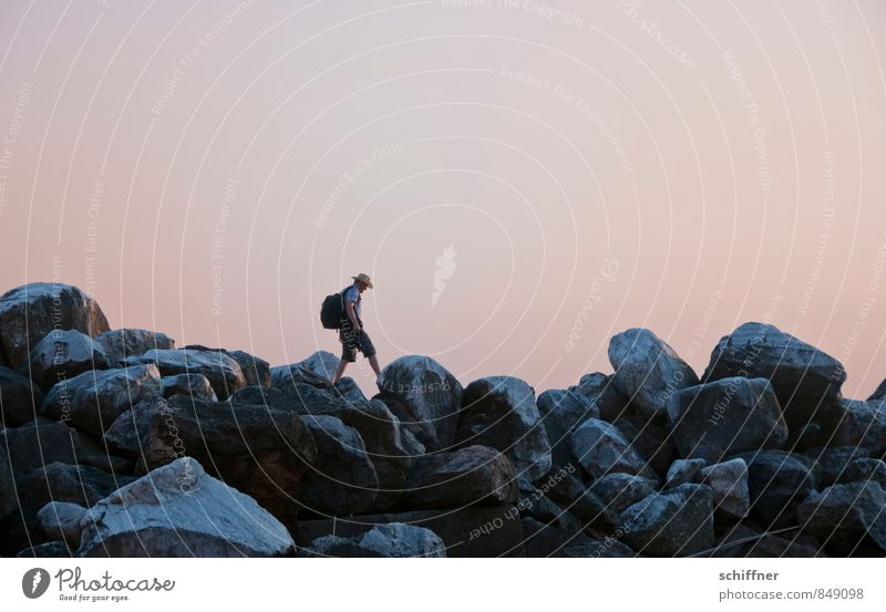 Large pebbles Human being Masculine Young man Youth (Young adults) 1 Landscape Cloudless sky Sunrise Sunset Rock Coast Going Ascending Jump Stone block