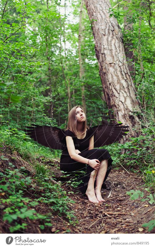 fallen angel Human being Feminine Young woman Youth (Young adults) Woman Adults 1 Forest Wing Angel Feather Sit Dream Wait Green Black Surrealism Colour photo