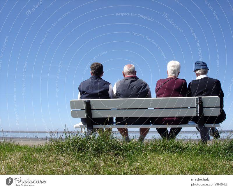 Pensioner couples on a bench in the summer, enjoying their pension and looking forward to the future Lifestyle Happy Healthy Health care Harmonious Well-being