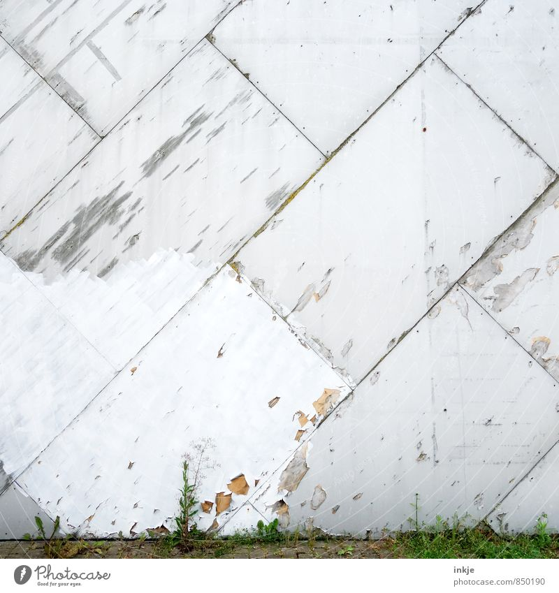ugly spot Deserted Wall (barrier) Wall (building) Facade Wall panelling Silicate mineral Line Prefab construction Diagonal Tilt Old Broken Environment Town