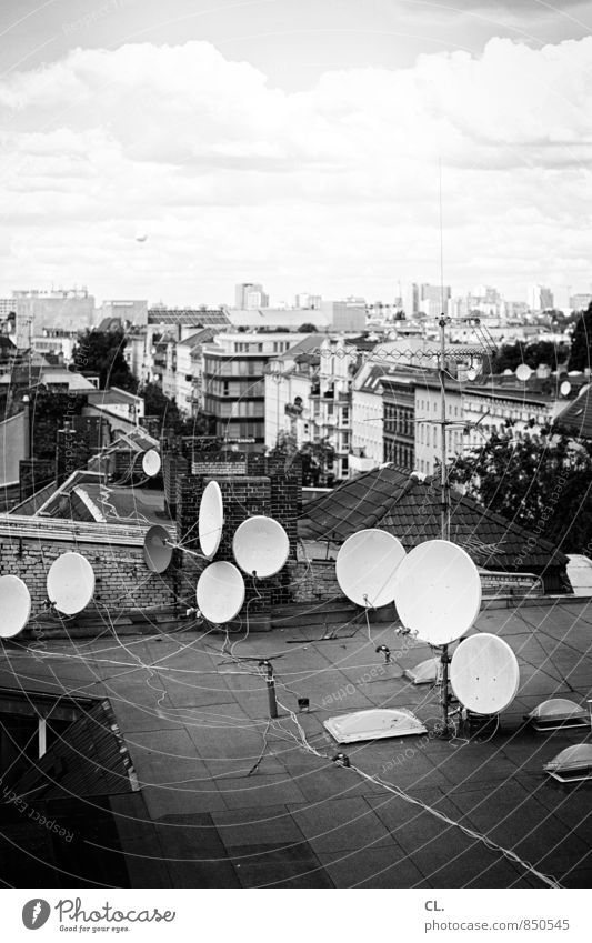 Above the roofs of Berlin Cable Satellite dish Environment Sky Clouds Town Capital city House (Residential Structure) Roof Hot Air Balloon Gloomy Chaos
