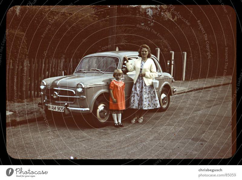 my grandmothers car Slide Vintage car Retro Munich Former old skirt street orange-red local road