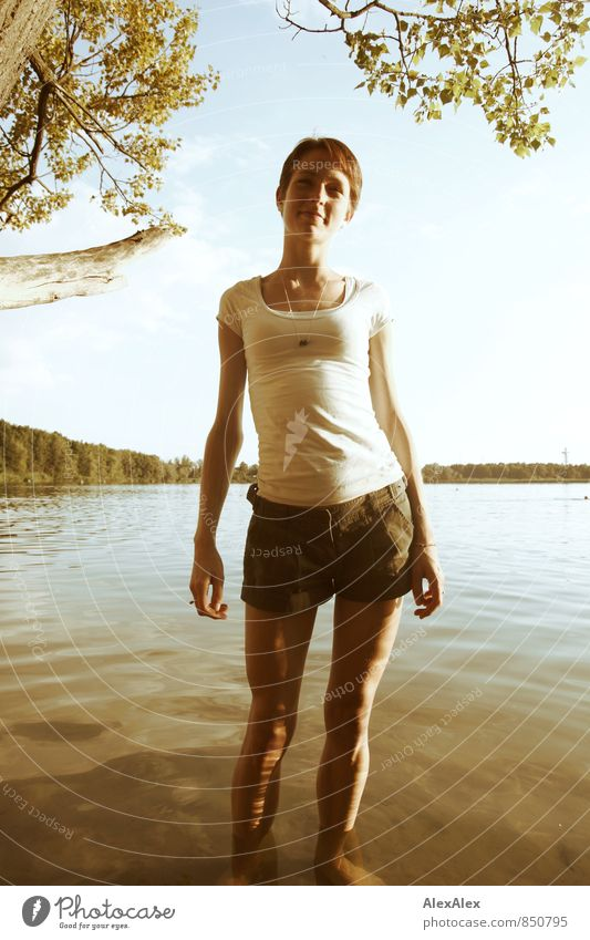The water's warm! Trip Adventure Summer Young woman Youth (Young adults) Body 18 - 30 years Adults Landscape Lakeside T-shirt Summer dress Brunette Long-haired