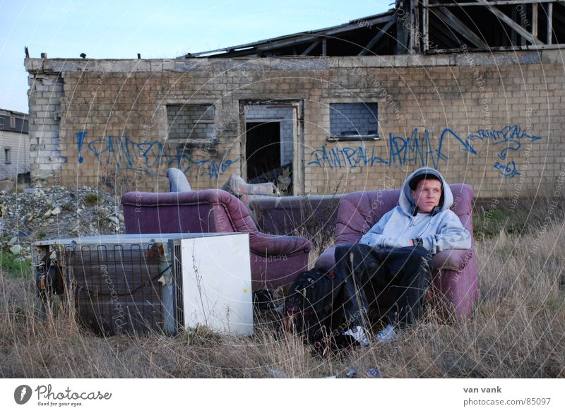 Youth (Young adults) Wall (building) Stone Wall (barrier) Think Chair Broken Sofa Trashy Destruction Artist Icebox Song Recitative Garbage dump Withdrawn