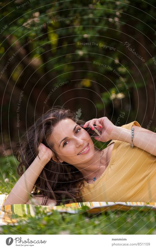 Portrait of a beautiful young woman talking on phone Human being Woman Nature Youth (Young adults) Beautiful Green Relaxation 18 - 30 years Yellow Adults Meadow Grass To talk Lie Park Lifestyle