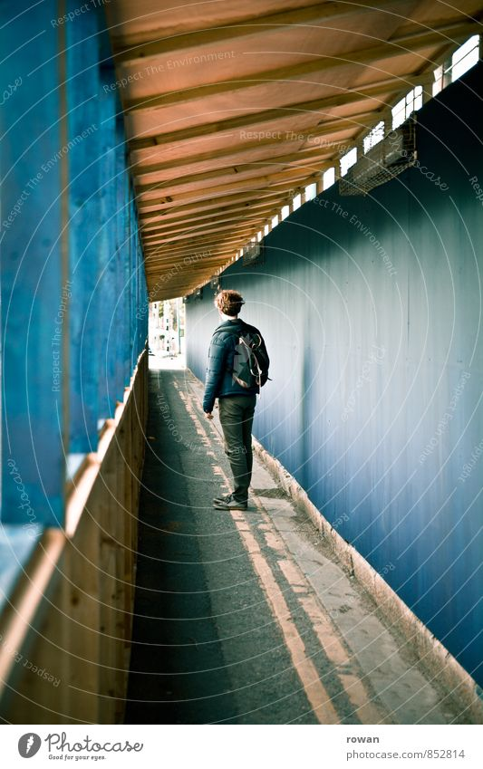 vanishing point Human being Masculine Young man Youth (Young adults) Man Adults 1 Blue Tunnel Stop short Looking Break City life Construction site Pedestrian
