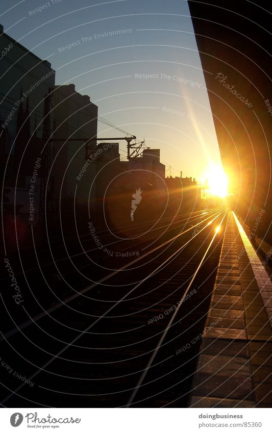Sky Sun Far-off places Architecture Railroad Perspective Electricity Train station Opinion Dusk Parallel