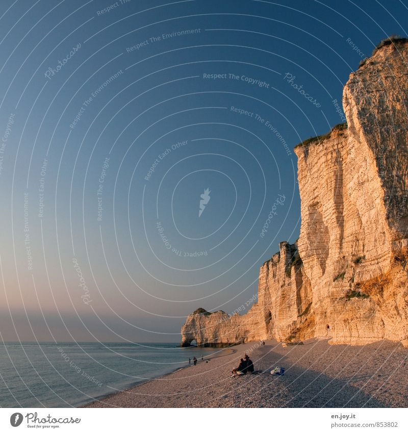 Human being Vacation & Travel Blue Summer Ocean Beach Yellow Coast Rock Horizon Couple Tourism Climate Tall Adventure Romance