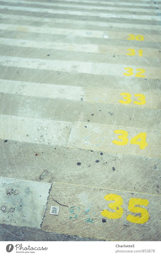 Olympic athlete Wall (barrier) Wall (building) Stairs Facade Stone Sand Concrete Characters Digits and numbers Yellow Gray 35 Crack & Rip & Tear Cut off
