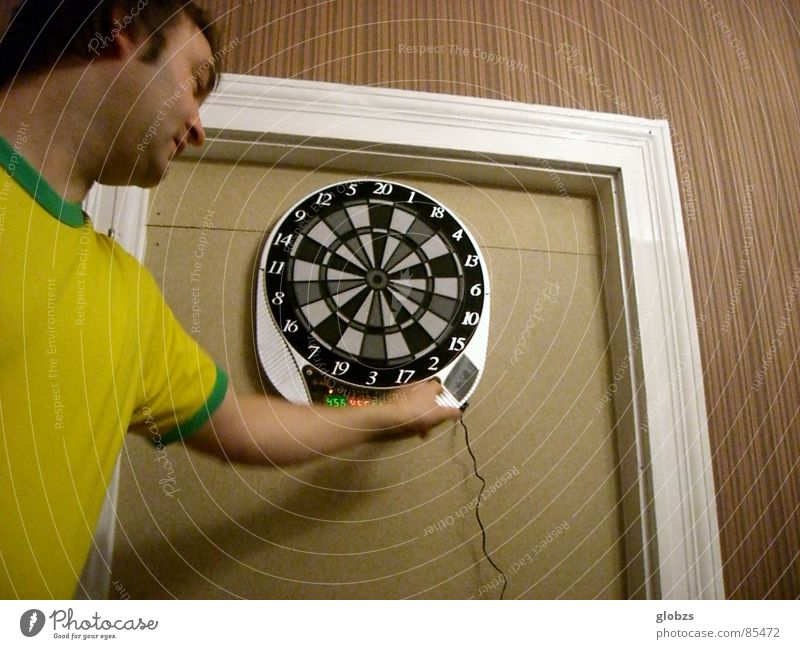 circuit Colour photo Interior shot Artificial light Worm's-eye view Upper body Looking away Joy Playing Darts Sporting event Masculine Young man