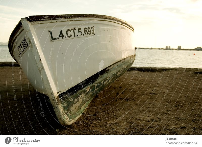 el barquito Watercraft Ocean Summer Upper body Fishing boat Shadow Resign Loneliness Redevelop Surface coating Layer of paint Evening Beach Coast Sun Sky Colour