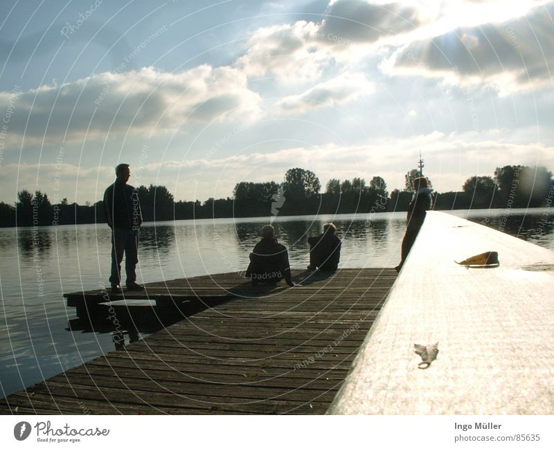 jetty at the lake Lake Bremervörde Bremen Bremerhaven Footbridge Mirror Mirror image Wood Woman Horizon Calm Glittering Human being Young man Glimmer Flash