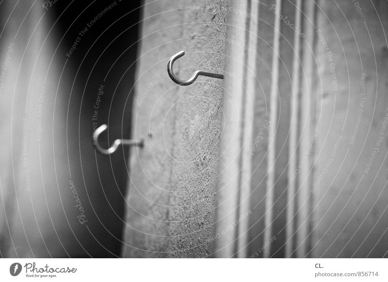hook Wall (barrier) Wall (building) Checkmark Orderliness Arrangement Hang up Attach Practical 2 Black & white photo Exterior shot Close-up Deserted Day