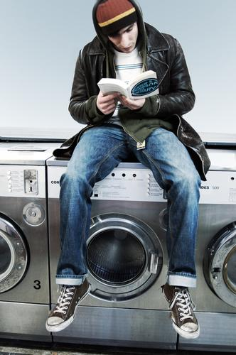 Youth (Young adults) Contentment Sit Wait Book Reading Media Clean Human being Cap Divide Print media Chucks Washing Laundry Easygoing