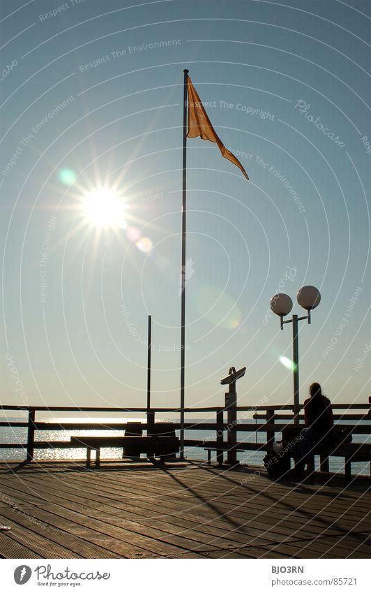 the eighth note aka. spot landing (now in color) Lake Tilt-Shift Jetty Flag Rod Lantern Portrait format Footbridge Plank Radiation Dazzle Ocean Binoculars